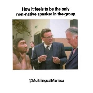 "A meme showing a caveman with two business men that reads ""How it feels to be the only non-native speaker in the group"""