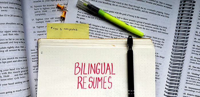 """The title """"bilingual resumes"""" on paper"""
