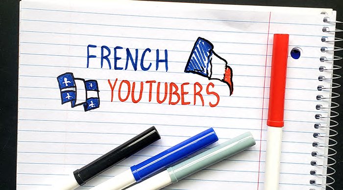 "The words ""French Youtubers"" doodled onto a notebook with markers"
