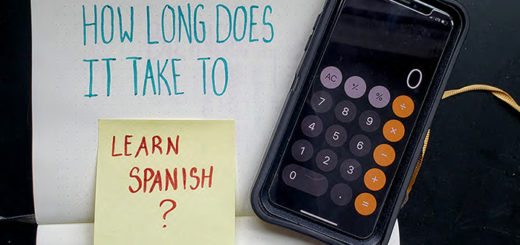 "Several notebooks which make up the word ""how long does it take to learn Spanish?"" with a calculator next to it"
