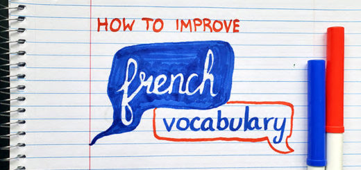 "The words ""how to improve French vocabulary"" on a notebook with markers"