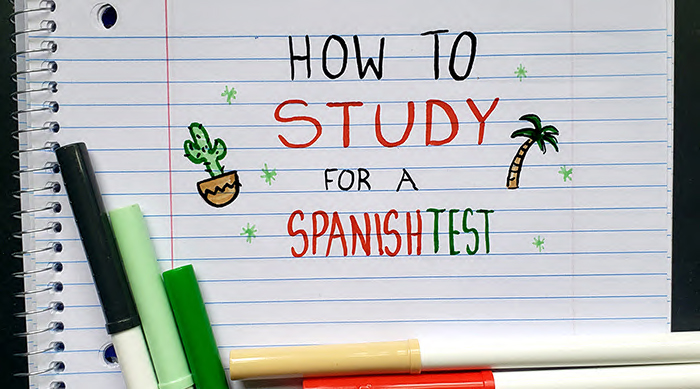 """The words """"how to study for a Spanish test"""" doodled onto paper with markers"""