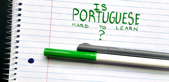"Paper with the words ""Is Portuguese Hard to Learn?"" written in green marker"