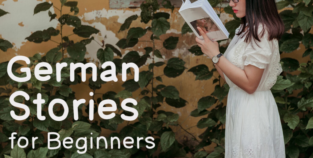 """The words """"German stories for beginners"""" hand written on a wall next to an image of a woman in a white dress reading a book."""