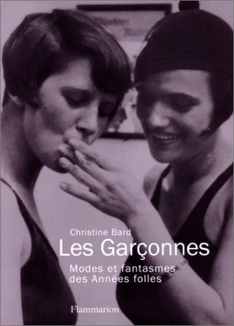 The cover of the French gender book Les Garçonnes. Two people are on the cover sharing a cigarette. The image looks like it's at least 70 years old, if not older. The gender of the two people is hard to identify.
